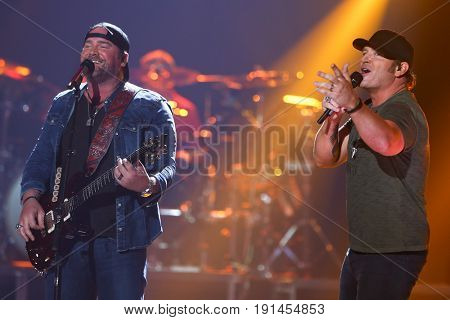 AUSTIN, TX - APRIL 30: Lee Brice (L) and Jerrod Niemann perform during the 2016 iHeartCountry Festival at The Frank Erwin Center on April 30, 2016 in Austin, Texas.