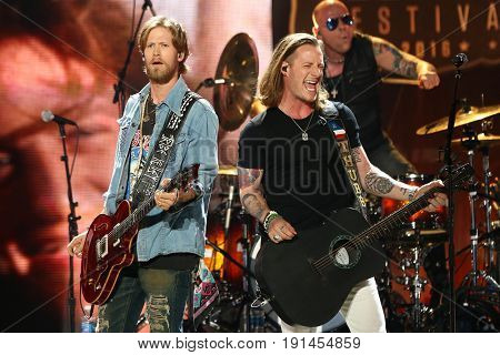 AUSTIN, TX - APRIL 30: Brian Kelley (L) and Tyler Hubbard of Florida Georgia Line perform during the 2016 iHeartCountry Festival at The Frank Erwin Center on April 30, 2016 in Austin, Texas.