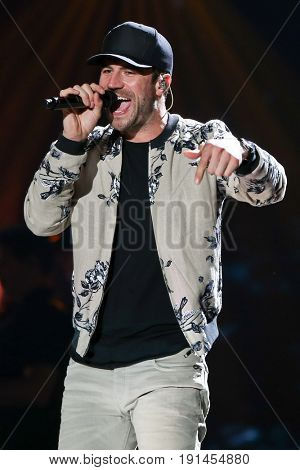 AUSTIN, TX - APRIL 30: Sam Hunt performs during the 2016 iHeartCountry Festival at The Frank Erwin Center on April 30, 2016 in Austin, Texas.