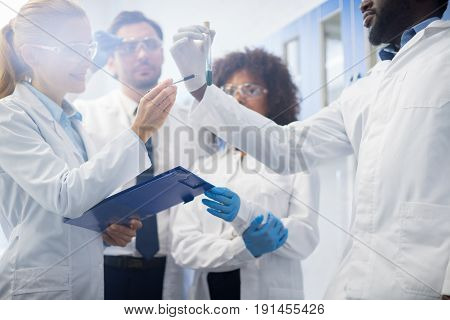Scientists Team Working In Laboratory Doing Research, Man And Woman Making Scientific Experiments Doctors In Lab