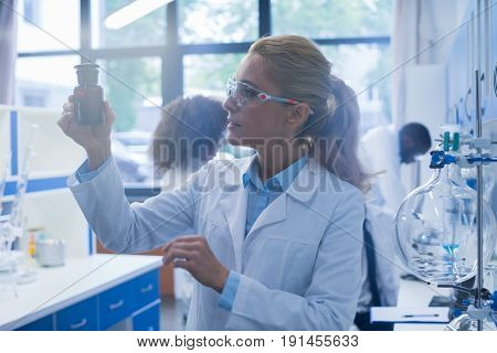 Young Woman Working In Laboratory Doing Research, Female Scientist Making Scientific Experiments In Lab