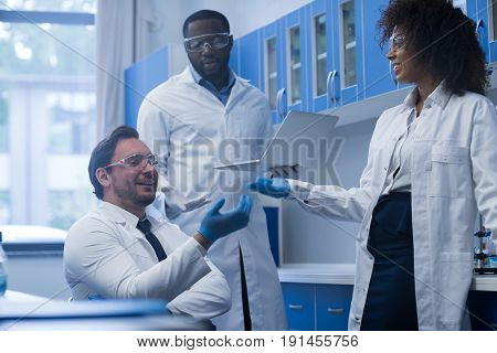 Mix Race Scientists Team Working In Laboratory Doing Research, Man And Woman Making Scientific Experiments Doctors In Lab