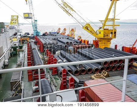 The Deck Lay Barge. Pipes And Lifting Cranes On The Ship. Equipment For Laying A Pipeline On The Sea