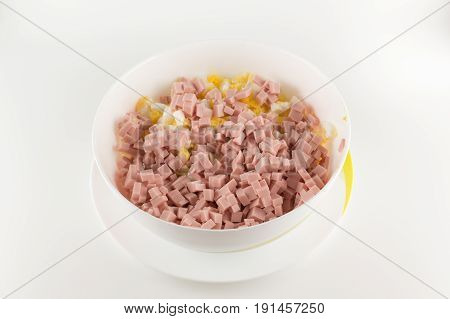 Cut sausage with egg is a preparation for meat salad