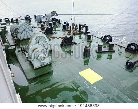 Mooring Part Of The Barge Deck. Babin With Chains From The Anchors. Mooring Devices. Bitteng On The