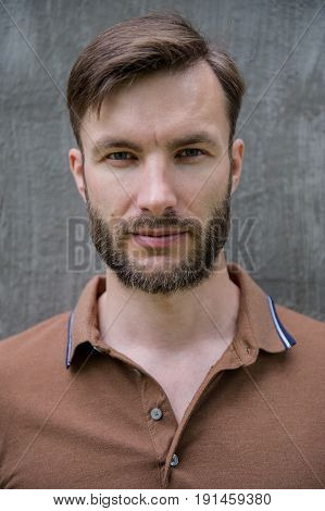 Emotional portrait of a young man with a beard