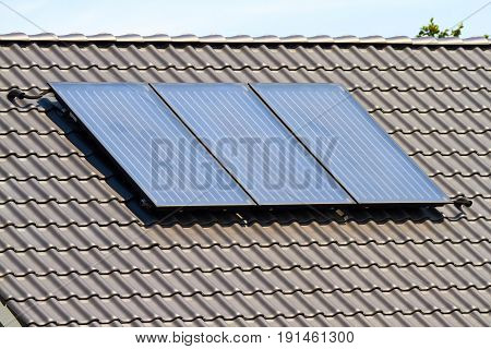 A solar collector on a roof creates warm water for solar heating.