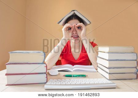 Human emotion facial expression reaction feelings education concept. little student girl with many books. School books on desk education concept