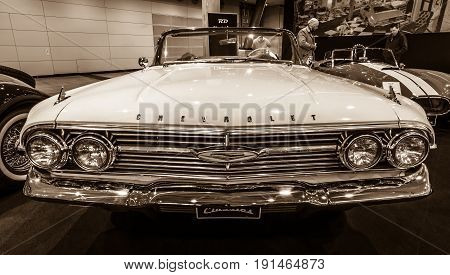 STUTTGART GERMANY - MARCH 02 2017: Full-size car Chevrolet Impala Convertible 1960. Sepia. Europe's greatest classic car exhibition