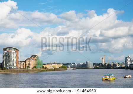 Wide River Canal, City Skyline, Residential Buildings On The Other Side Of The Shore, Beautiful Dist