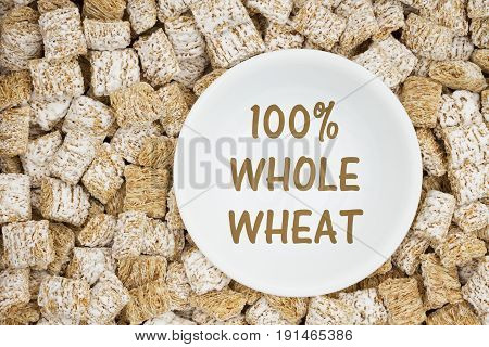 100% whole wheat text with whole grain wheat cereal with a white bowl