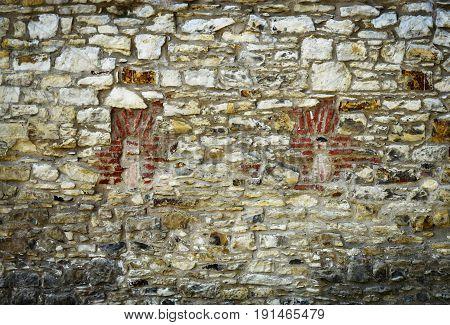 abstract background masonry Locked windows on the stone wall