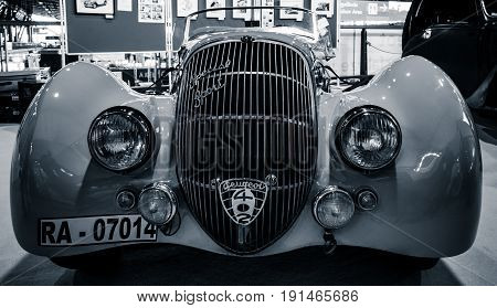 STUTTGART GERMANY - MARCH 02 2017: Sports car Peugeot 402 Darl'mat Special Sport Roadster 1937. Toning Stylization. Europe's greatest classic car exhibition