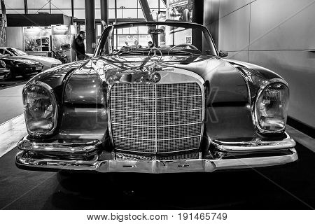 STUTTGART GERMANY - MARCH 02 2017: Full-size luxury car Mercedes-Benz 300 SE Cabriolet (W112) 1967. Black and white. Europe's greatest classic car exhibition