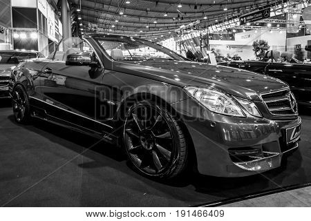 STUTTGART GERMANY - MARCH 02 2017: Mid-size luxury sports car Mercedes-Benz E500 (A207) 2010. Black and white. Europe's greatest classic car exhibition