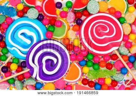 Background Of Colorful Assorted Candies Including Lollipops, Gum Balls, And Jelly Candies