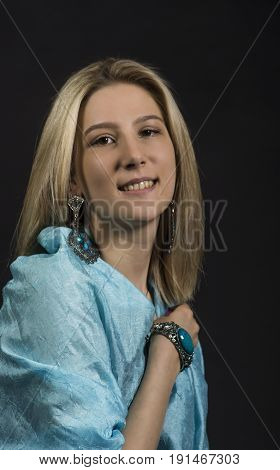 Portrait Of A Girl In A Turquoise Cape.