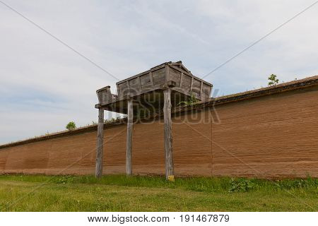 MORIOKA JAPAN - MAY 22 2017: Reconstructed watchtower and clay wall (tsuijibei) of Shiwa Castle in Morioka Japan. Castle was erected in 803 against local emishi tribes and abandoned in 811