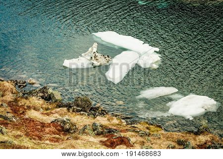 Ice Fragments In River Or Lake Water, Blue Background