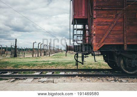 Oswiecim Poland - June 14 2017: Auschwitz-Birkenau concentration camp railway carriiage on June 14 2017 in Oswiecim Poland.