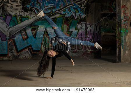 Female Dancer Doing Handstand And Leg Split