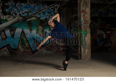 Male Urban Dancer Standing On His Toes