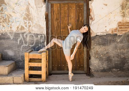 Ballet Dancer Stretching Outdoors