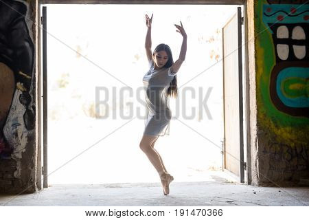 Pretty Ballerina Performing Outdoors