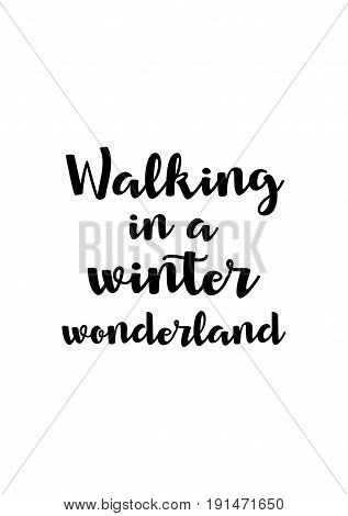 Isolated calligraphy on white background. Quote about winter and Christmas. Walking in a winter wonderland.