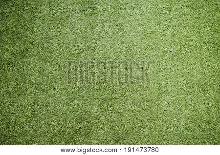 Artificial grass background on floor in garden