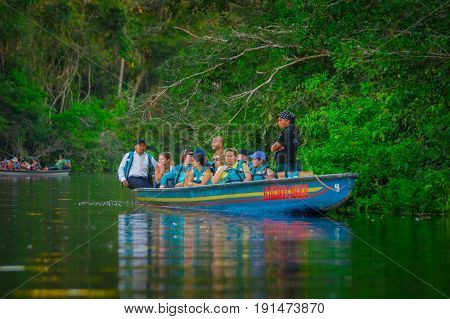 CUYABENO, ECUADOR - NOVEMBER 16, 2016: Unidentified people travelling by boat into the depth of Amazon Jungle in Cuyabeno National Park, Ecuador.