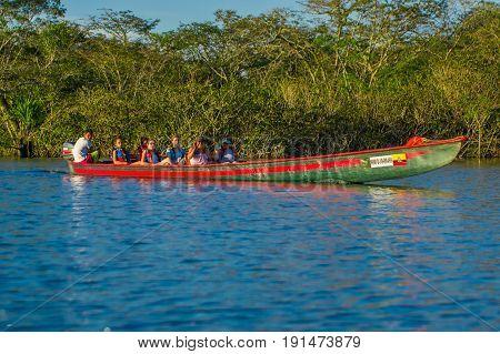 CUYABENO, ECUADOR - NOVEMBER 16, 2016: Unidentified people travelling by boat in Cuyabeno National Park, Ecuador.