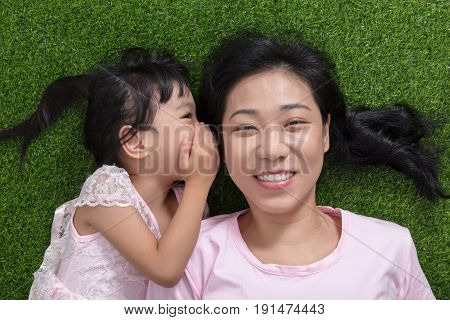 Asian Chinese Mother And Daughter Whispering And Gossiping
