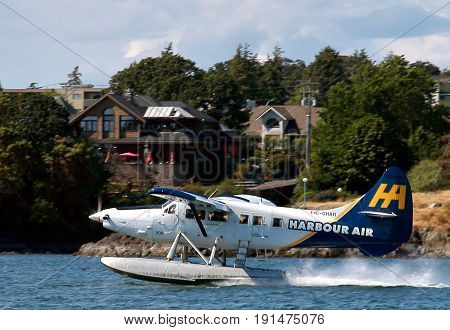Victoria, Canada - May 29, 2016: Seaplane taxiing in Victoria Harbor, Vancouver Island.