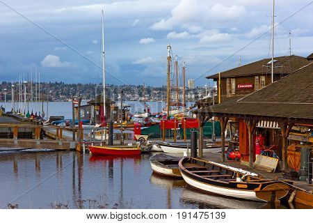 SEATTLE USA - MARCH 22 2016: Center for Wooden Boats museum on Lake Union on March 22 2016 in Seattle WA USA. Panorama of the lake during cloudy sunset.