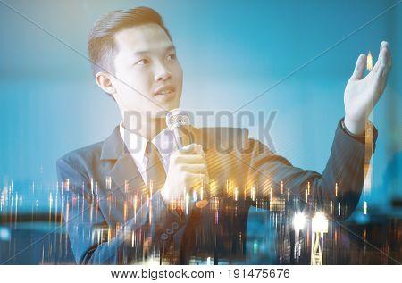 smart businessman speech talking with microphone on blur city night light background