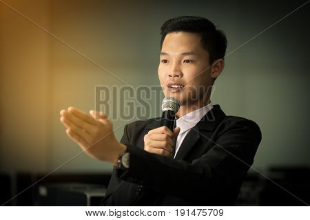 smart businessman speech talking with microphone gray scale tone