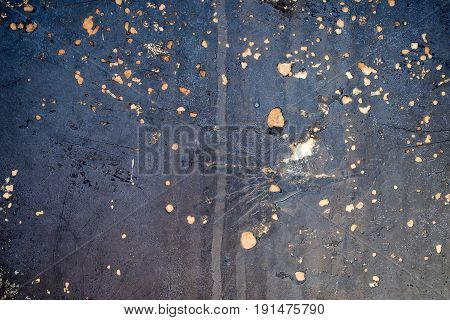 corrosive rusty spots on faded blue painted blue metal surface