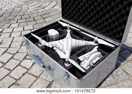 KAGAWA, JAPAN - JUNE 14, 2017: White drone Dji Phantom 4 Pro stay in metal bag and ready to fly.