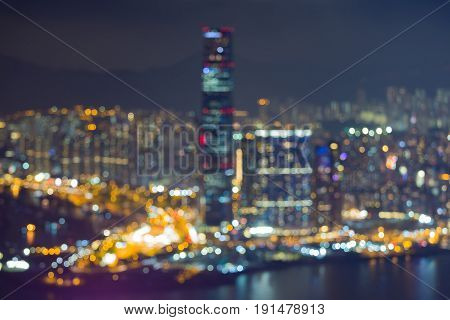 Blurred night twilight Hong Kong business downtown over Victoria bay abstract background
