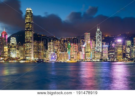 Water front blurred bokeh light Hong Kong cityscape downtown central business downtown abstract background
