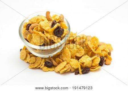 Homemade a glass bowl of honey caramel cornflakes on white background