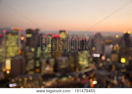 City blurred bokeh ligth Osaka city business downtown abstact background Japan