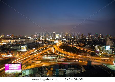 Aerial view city highway interchanged skyline blurred bokeh light night view abstract background