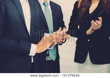 Closeup photo of partners clapping hands after business seminar.