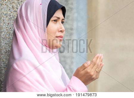 happy muslim woman with full hijab in pink dress asian traditional style dress praying for Allah Muslim God