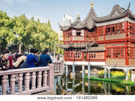 Shanghai, China - Nov 4, 2016: Around Yu Yuan (Yu Garden) - Old buildings with architectural structures in traditional Chinese styling converted to modern-day teahouse. Busy scene.