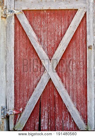 An old barn door showing its weathered texture