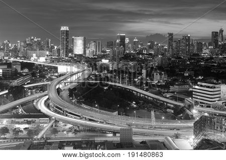 Black and White Aerial view highway intersection and city downtown backgroud Bangkok Thailand