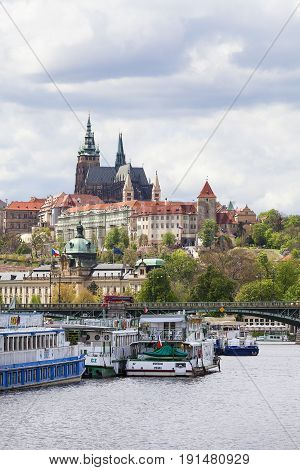PRAGUE CZECH REPUBLIC - MAY 2 2017 :View of Hradcany and river Vltava with tourist boats. Vltava cruises are a great tourist attraction especially on sunny days